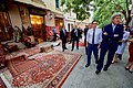 Secretary Kerry Looks at Georgian Carpets Outside a Shop in the Historic District of Tbilisi (28098612906).jpg
