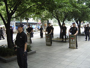 National Police Agency (South Korea) - Riot Police of the SMPA stand ready with riot shields