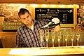 Server pouring Henry of Pelham sparkling wine in flutes.jpg