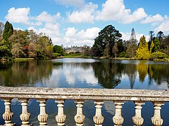 Sheffield Park House from the Top Bridge in Sheffield Park Gardens-26797406902.jpg