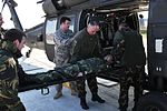 Simulating a patient load onto a medevac helicopter 140311-A-SW743-005.jpg