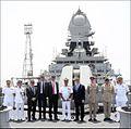 Sir Michael Fallon, Vice Admiral Girish Luthra, a UK delegation, and Indian Navy personnel on board INS Kolkata.jpg