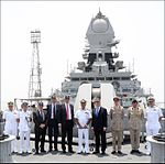 Sir Michael Fallon, Vice Admiral Girish Luthra, a UK delegation, and Indian Navy personnel on board INS Kolkata.jpg