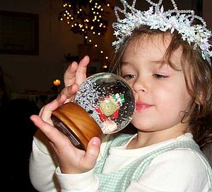 Snow globe - A girl holding a snow globe