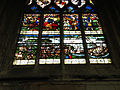 Stained glass program depicting a boat being towed, south nave aisle, Notre-Dame-des-Arts, Pont-de-l'Arche.jpg