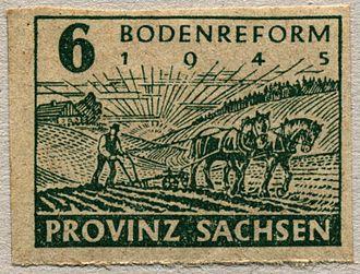 Heinrich Rau - Stamp advertising the 1945 land reform