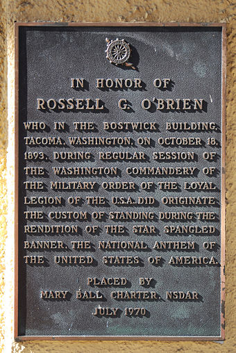 Plaque detailing how the custom of standing during the U.S. national anthem came about in Tacoma, Washington, on October 18, 1893, in the Bostwick building Star Spangled Banner Plaque.jpg