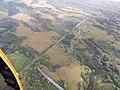 Starr-141014-2267-Andropogon virginicus-aerial view ditch-Haiku-Maui (25154180991).jpg