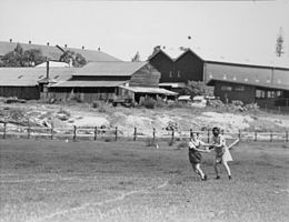 StateLibQld 1 107544 Two girls participating in a game of baseball, Brisbane, 1938.jpg