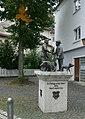Statue im Schweinmarktplatz, Ulm (Striking a deal) - geo.hlipp.de - 21326.jpg