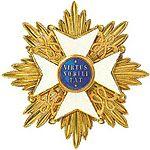 Een ster zoals van de Orde van de Nederlandse Leeuw, zoals die door de prins wordt gedragen.