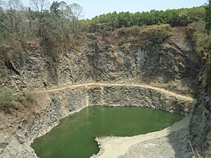 Quarry - An abandoned stone quarry in Kerala, India with a pond in it.