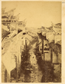 Street of Congyang between Hui-Style Houses with Decorated Roofs and Carved, Upturned Eaves. Hubei Province, China, 1874 WDL2102.png