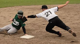 A player trying to avoid a tag at third base. Tagget out.jpg
