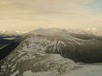 Takshanuk Mountains - A view of the southern end of the Takshanuk Mountains. The Chilkat River can barely be glimpsed in the lower lefthand corner.