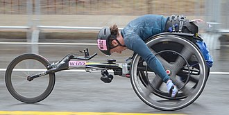 Tatyana McFadden - Tatyana McFadden near halfway point of Boston Marathon 2018 in which she got first place.