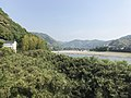 Tenshu of Iwakuni Castle, Kintaikyo Bridge and Nishikigawa River from west end of Garyubashi Bridge.jpg