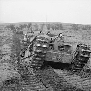 31st Armoured Brigade - Churchill tanks of 'B' Squadron, 9th Royal Tank Regiment during an exercise at Tilshead on Salisbury Plain, 31 January 1942. The lead vehicle is named 'Jester'.