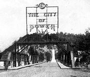 "Electrically lighted ""The City of Power"" sign that was erected over the old Broad Street Bridge in Elizabethton (circa 1912-1913)."