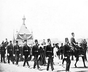 Amir al-hajj - The kiswah being transported from Cairo to Mecca surrounded by an Egyptian armed guard, 1911