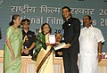 "The President, Smt. Pratibha Devisingh Patil presenting the Award for Best Supporting Actor to Shri Arjun Rampal for Hindi film ""Rock On"", at the 56th National Film Awards function, in New Delhi on March 19, 2010.jpg"