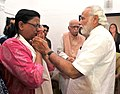 The Prime Minister, Shri Narendra Modi visited the residence of Shri L.K. Advani and paid tributes to late Smt. Kamla Advani, in New Delhi on April 06, 2016.jpg