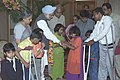 The Prime Minister Dr. Manmohan Singh with the differently abled children who tied Rakhi to him during the auspicious occasion of 'Raksha Bandhan', in New Delhi to August 19, 2005.jpg