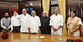 The Vice President and Chairman, Rajya Sabha, Shri M. Hamid Ansari with the newly elected Members of Rajya Sabha, Shri L. Ganeshan and Smt. Roopa Ganguly, at a Swearing-in Ceremony, at Parliament House, in New Delhi.jpg