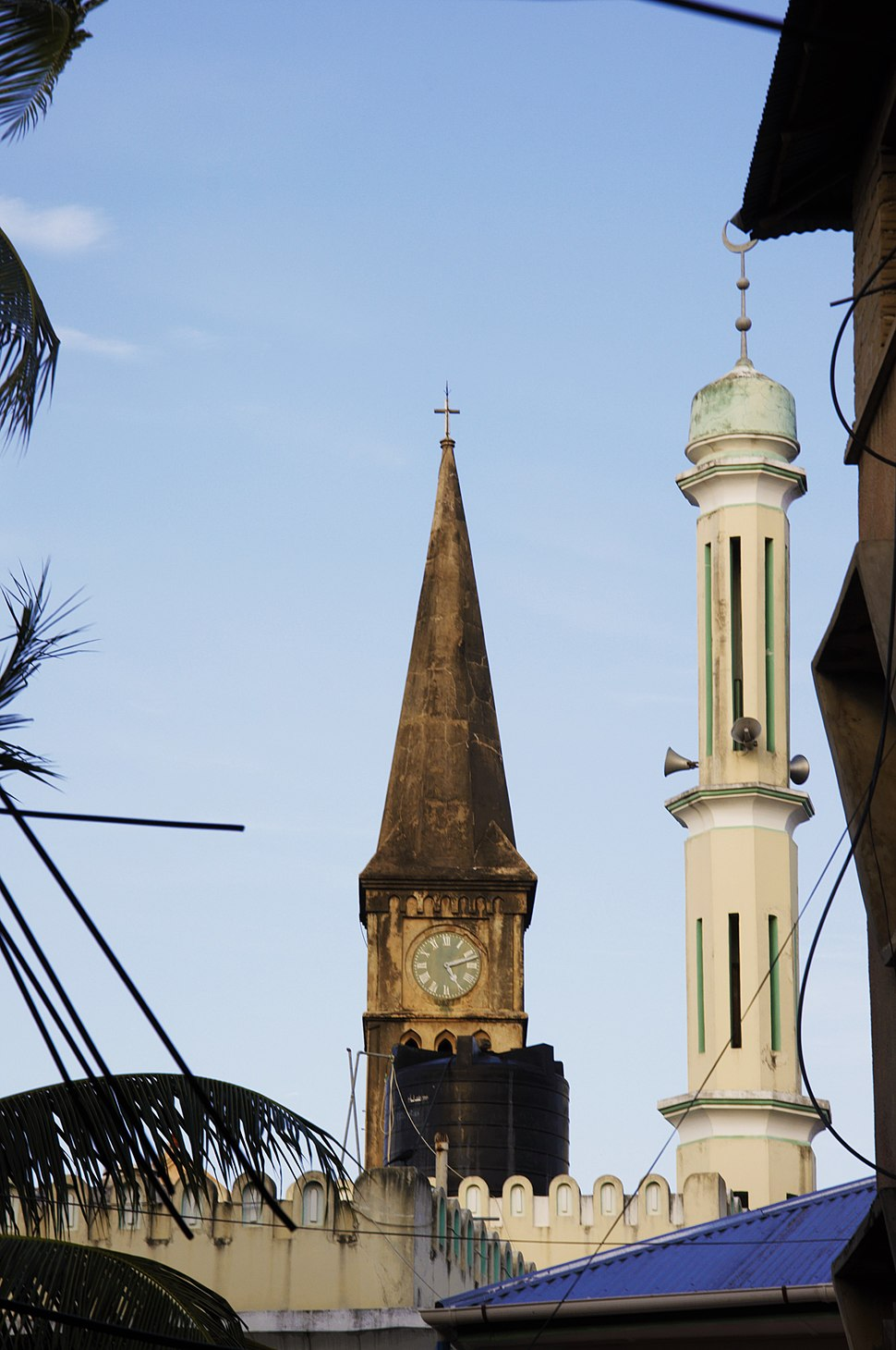 The mosque and church are located closely in the stone city of Zanzibar