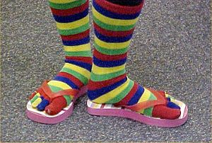 Rainbow striped toe socks worn with thong sandals
