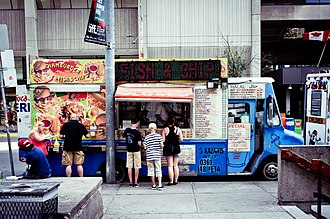 Cuisine in Toronto - A food truck parked behind an ice cream truck in front of Toronto City Hall