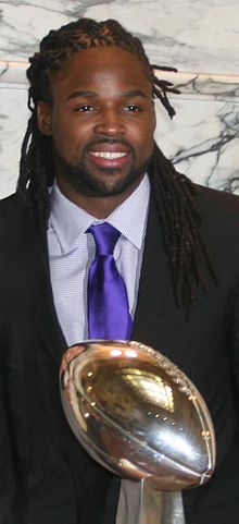 Torrey Smith and 2013 Superbowl trophy.jpg