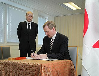2011 in Ireland - Taoiseach Enda Kenny (right), visited to the Embassy of Japan in Dublin, to sign a book of condolence for the victims of the 2011 Tōhoku earthquake and tsunami, and he met with Japanese Ambassador to Ireland Toshinao Urabe (left), on 22 March 2011.