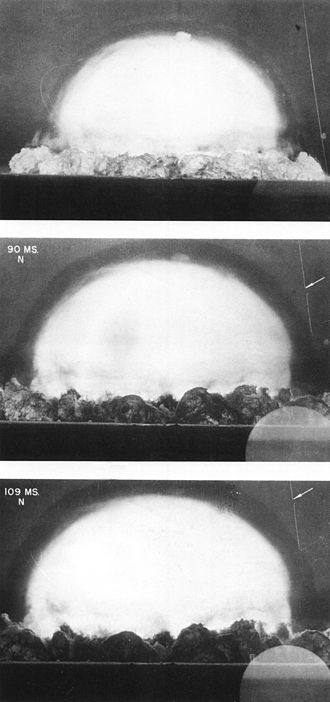 Shock wave - Shock wave propagating into a stationary medium, ahead of the fireball of an explosion. The shock is made visible by the shadow effect (Trinity explosion)