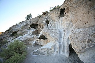 Cliff dwelling - Cavates and pathways in soft tuff at Tsankawi, New Mexico