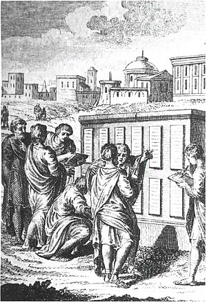 Twelve Tables - Roman civilians examining the Twelve Tables after they were first implemented.