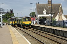 Two diesel trains pass each other in Ridgmont station.jpg