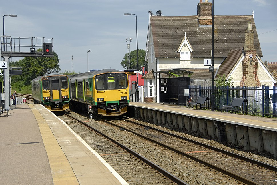 Two diesel trains pass each other in Ridgmont station