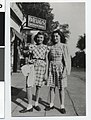 Two girls standing outside Desnick's Drug Store, Minneapolis (4418733539).jpg