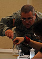 U.S. Army Capt. Randy Cuyler, a hydrologist with the 3-19th Agribusiness Development Team, Indiana Army National Guard, helps teach a science experiment during his mobilization training at Franklin Community 100907-A-AO424-008.jpg