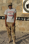 U.S. Army Spc. T'Ola Winston, an orderly room clerk with Charlie Company, Headquarters and Headquarters Battalion, 4th Infantry Division, poses with a Florida State football T-shirt at Kandahar Airfield 131004-Z-MH103-001.jpg