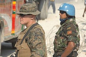 Sri Lanka Armed Forces - Sri Lanka Army Peacekeeper with US Marine Corps Cpl