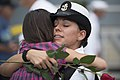 U.S. Navy Chief Cryptologic Technician (Technical) Juliann Gonzales, right, assigned to the amphibious dock landing ship USS Pearl Harbor (LSD 52), hugs her daughter in San Diego after returning from 130826-N-ZU025-149.jpg