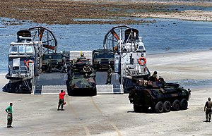 Landing Craft Air Cushion - USMC LAV-25s and HMMWVs are offloaded from a USN LCAC craft at Samesan RTMB, Thailand