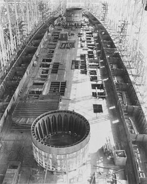 USS Saratoga (CV-3) - Saratoga on 8 March 1922, after her construction had been suspended. There are circular barbettes on blocks on her deck, which would have been used for the battlecruiser's main battery