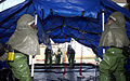 US Air Force (USAF) Airmen of the Patient Decontamination Team, 305th Medical Group (MDG), McGuire Air Force Base (AFB), New Jersey (NJ), set up an In Place Patient Decontamination Tent during a simulated bomb 040603-F-KF493-004.jpg