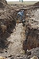 US Army 51402 Fort Riley, Fort Leonard Wood Soldiers work together on trench project.jpg