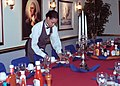 US Navy 020325-N-4748O-001 Mess Specialist Prepares Dinner Table.jpg