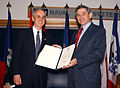 US Navy 030123-N-1928O-003 Paul Wolfowitz, Deputy Secretary of Defense, presents the Department of Defense Distinguished Public Service Award to the Honorable Gordon England, Secretary of the Navy (SECNAV).jpg