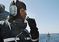 US Navy 030609-N-4374S-006 Seaman Apprentice Calais Thamous reports a surface contact as he stands the starboard lookout watch aboard the aegis cruiser USS Vella Gulf (CG 72).jpg